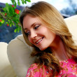Beautiful young woman relaxing at home - Stock Photo
