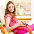 Beautiful young woman relaxing at home — Stock Photo