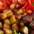 Meat plate with potatoes and souce — Stock Photo