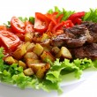 Meat plate with potatoes and souce - Stock Photo