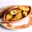 Dish with potatoes — Stock Photo