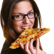Beautiful young woman eating pizza — Stock Photo #4197129