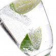 Stock Photo: Glas of water with ice and lime