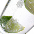 Glas of water with ice and lime — Stock Photo