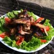 Chicken legs on the grill with vegetables - Stock fotografie