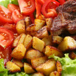 Meat plate with potatoes and souce - Foto de Stock