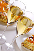 Dessert fruit cake with champagne — Stock Photo