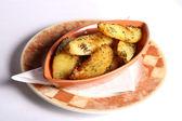 Dish with potatoes — Stock Photo