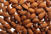 A brown background with fresh nuts — Stock Photo