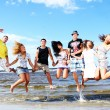 Happy teenagers playing at the sea — Foto Stock