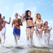 Happy teenagers playing at the sea — Stock Photo #4300672