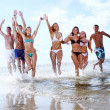 Happy teenagers playing at the sea — Stock Photo