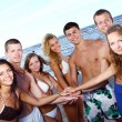happy teenagers playing at the sea — Stock Photo #4300683