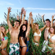 Happy teenagers playing at the sea — Stock Photo #4300705