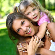 Sweet and beautiful girl with mom — Stock Photo #4300708