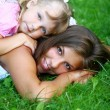 Sweet and beautiful girl with mom — Stock Photo