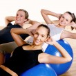 Group doing fitness exercises — Stock Photo #4300727