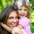 Sweet and beautiful girl with mom — Stock Photo #4300749