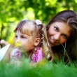 Sweet and beautiful girl with mom — Stok fotoğraf
