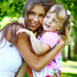 Sweet and beautiful girl with mom — Stock Photo #4300772
