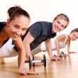 Group doing fitness exercises — Zdjęcie stockowe #4300775