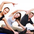 Group doing fitness exercises — Stock Photo #4300782