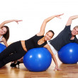 Group doing fitness exercises — Stock Photo #4300784