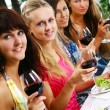 Group of beautiful girls drinking wine - Stock Photo