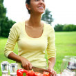 Smiling and beautiful woman cooking — Stock Photo #4301015