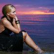 Sexy and luxury woman on the sunset background — Stock Photo
