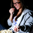 Beautiful girl watching new movie - Stock Photo