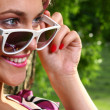 Beautiful young woman with sunglasses — Stock Photo