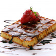 Fresh sweet chocolate waffles with strawberry - Stock Photo