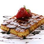 Fresh sweet chocolate waffles with strawberry — Stock Photo