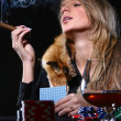 Beautiful woman which smoke cigar — Stock Photo