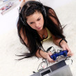 Young and beautiful girl play videogame — Stock Photo