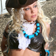 Beautiful blond woman in pirate image - Stockfoto