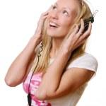 piękna kobieta młody i szczęśliwy słuchania muzyki — Zdjęcie stockowe #4302317