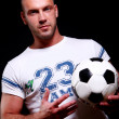 Young and attractive football player — Stock Photo
