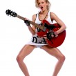 Sexy young woman with red guitar — Stock Photo