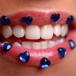 Woman mouth with deep blue jewels — Stock Photo #4302665
