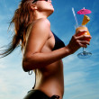 Young and attractive lady drink fresh summer fruit cocktail - Stock Photo