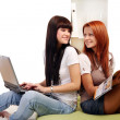 Two young and beautiful girls in room — Stock Photo