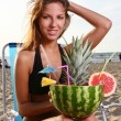 Young and attractive lady drink fresh summer fruit cocktail — Stock Photo #4302682