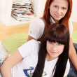 Two young and beautiful girls in room - Foto Stock