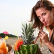 Young and attractive lady drink fresh fruit cocktail — Stock Photo #4302686