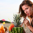 Stock Photo: Young and attractive lady drink fresh fruit cocktail