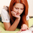Beautiful young and sexy  red haired girl reading book — Foto Stock