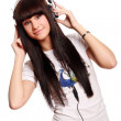 Beautiful young and sexy girl with headphones — Stockfoto