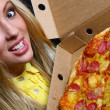 Beautiful young woman eating pizza - 